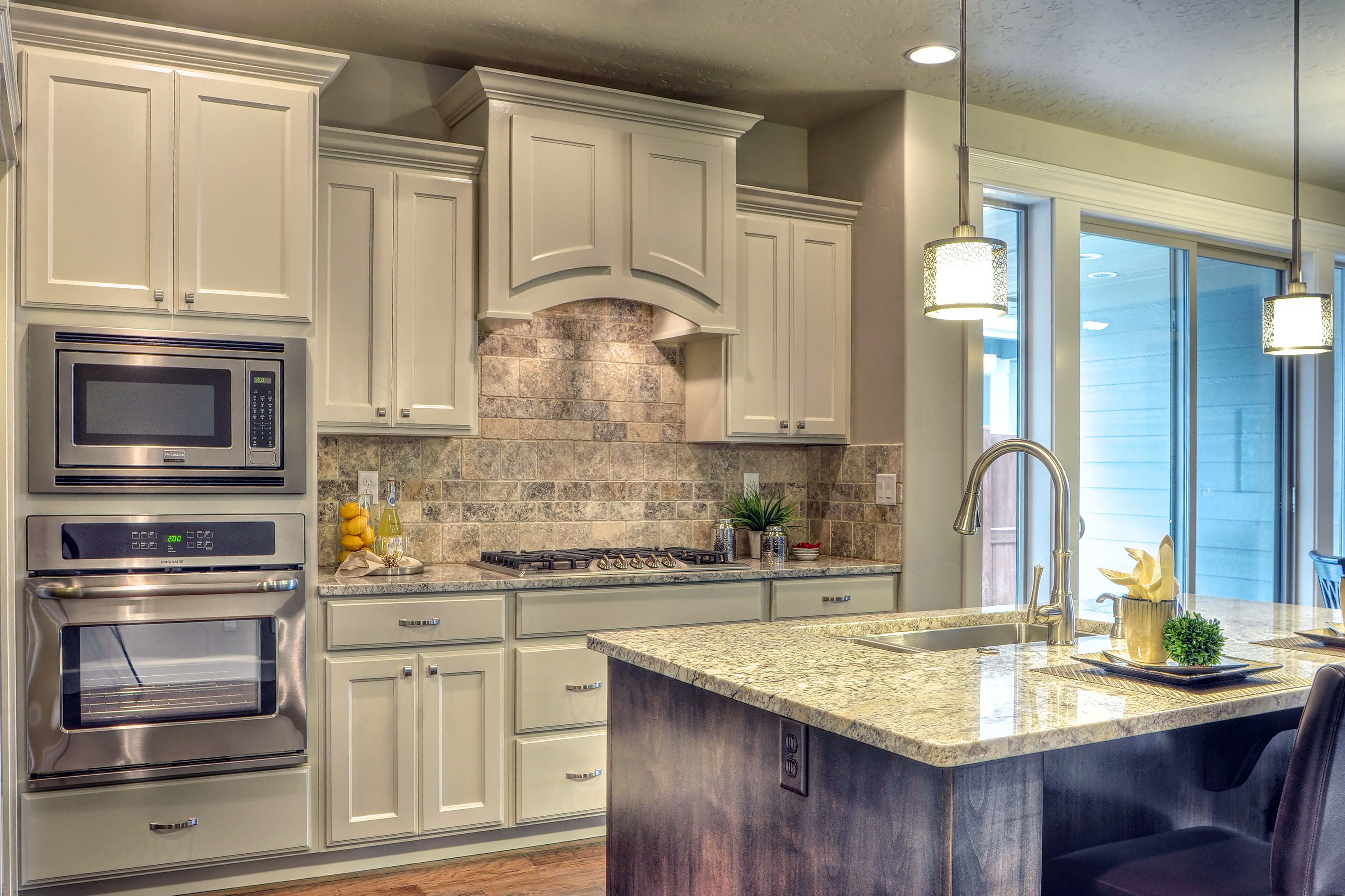 sherwin williams snowbound painted cabinets make the kitchen feel bigger and elegant. Interior Design Ideas. Home Design Ideas