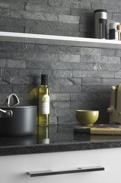 The Ultimate Guide To Backsplashes Via Purewow Slate Wall Tiles Grey Kitchen