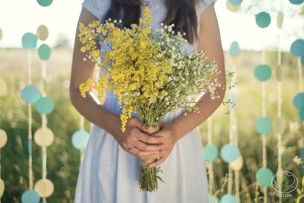 """By """"Cotton"""" Photography & Decor Studio http://www.cottonwedding.com/  cyan, blue, yellow pastel candy bar decorated with paper flowers. hand made sweets paper decor, paper wall sunset love story on grass field"""