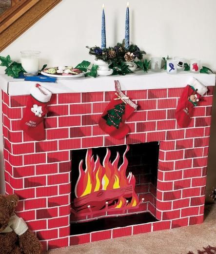 """Nostalgic Fireplace 3D Cardboard Kit   Create your own Christmas scene with this 3D 30"""" high x 38"""" wide fireplace cardboard kit. Easy assembly required.     Allow 2-3 weeks delivery."""