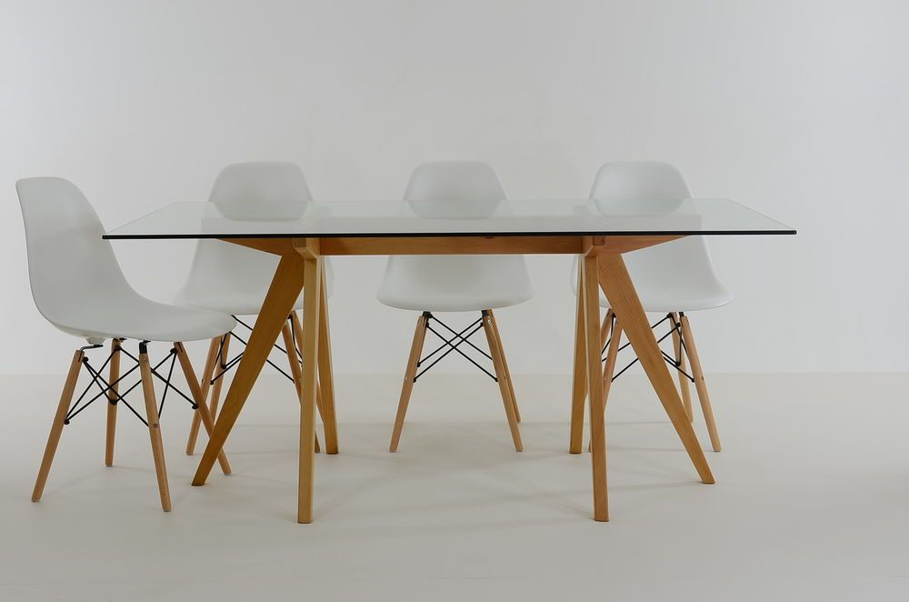 White Eames Chair. White table with wood legs. Home