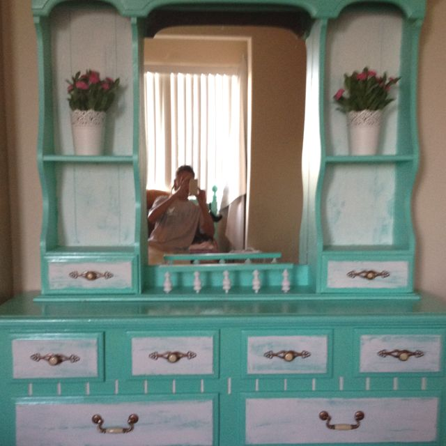 Refinished my old dark, outdated furniture. Gave it a shabby chic facelift, and voila! Stripped off old varnish, sanded, two coats of primer, one coat of Tiffany Blue, some crackle plaster for effect, and two coats of polyurethane ( sanded in between of course) BIG job, but well worth the effort. I'll post the rest of the furniture once I get my new matching bedding!
