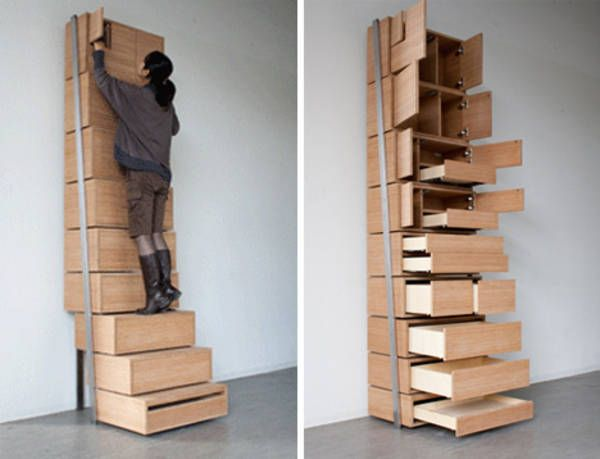 Amazing Staircase Storage: Vertical Shelving Unit Is Its Own Stepladder . Brilliant  For A Shorty Pants