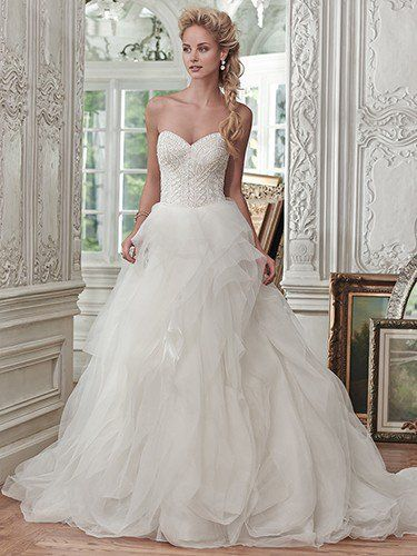 Maggie Sottero - O'HARA, Lightweight tulle and Chic organza create the breathtaking skirt of the Ohara ball gown wedding dress, with sparkling beaded bodice and romantic sweetheart neckline completing the look. Finished with covered buttons over zipper and inner corset closure.