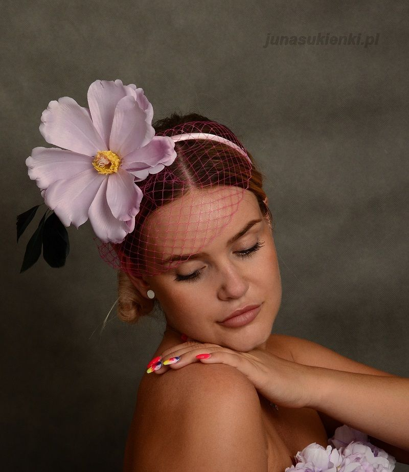bf56cffa PINK FASCINATOR WITH FLOWER AND VEIL Romantic fascinator in light purple  and pink tones, mounted on satin headband. Decorated with large magnolia,  ...