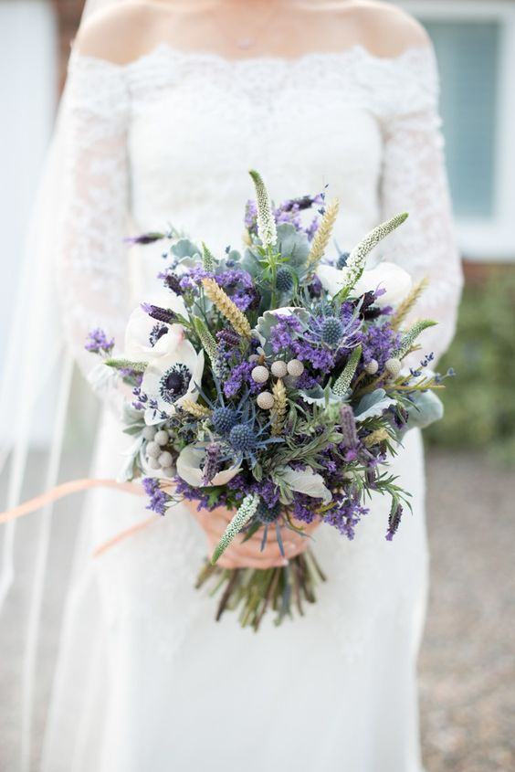 Wheat Purple Lavender White Anemones Blue Thistles And Various Greenery For A Colorfu Purple Wedding Bouquets Purple Wedding Flowers Spring Wedding Bouquets