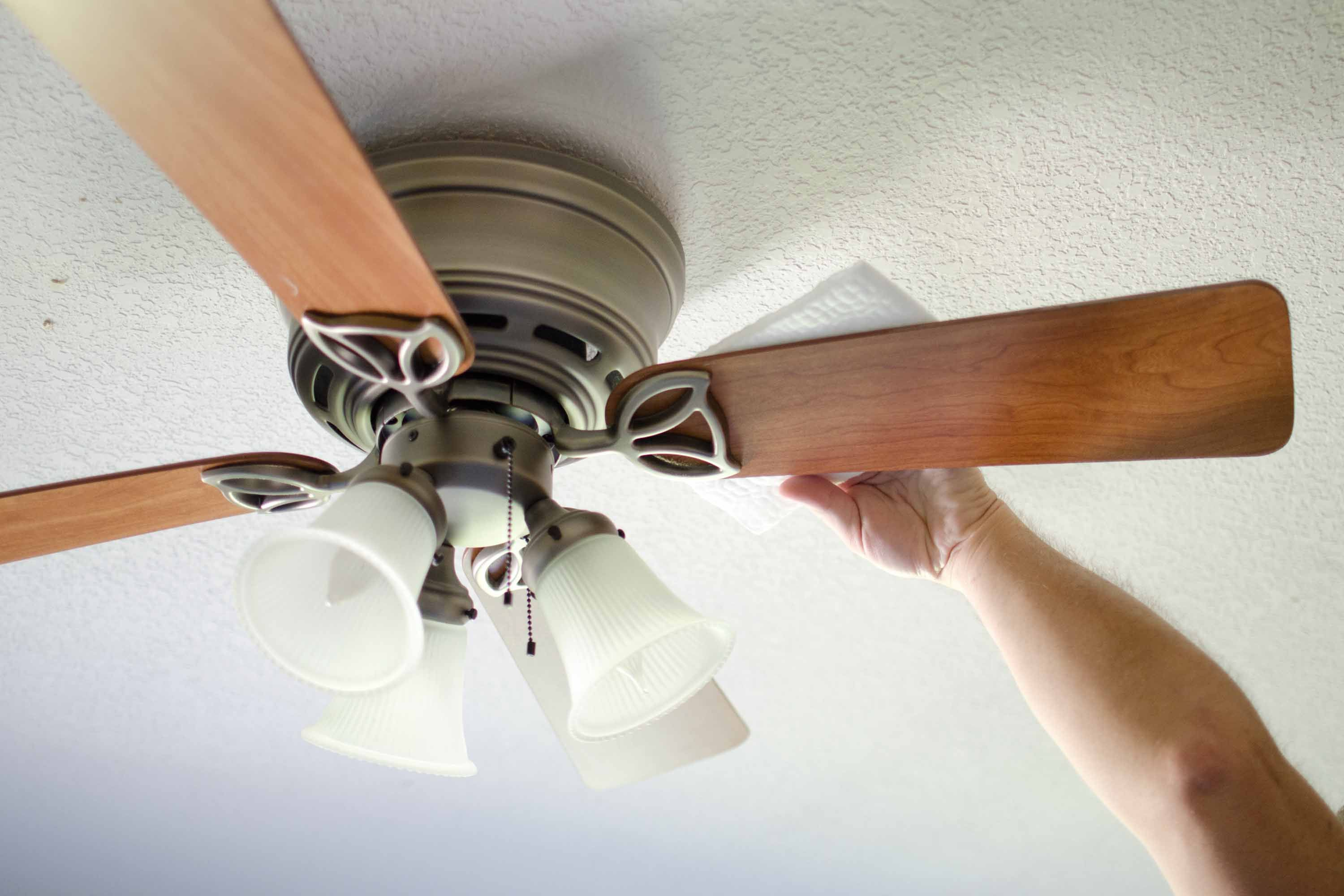How To Keep Your Ceiling Fans Dust Free Hunker Ceiling Fan Cleaning Ceiling Fans Ceiling Fan Direction