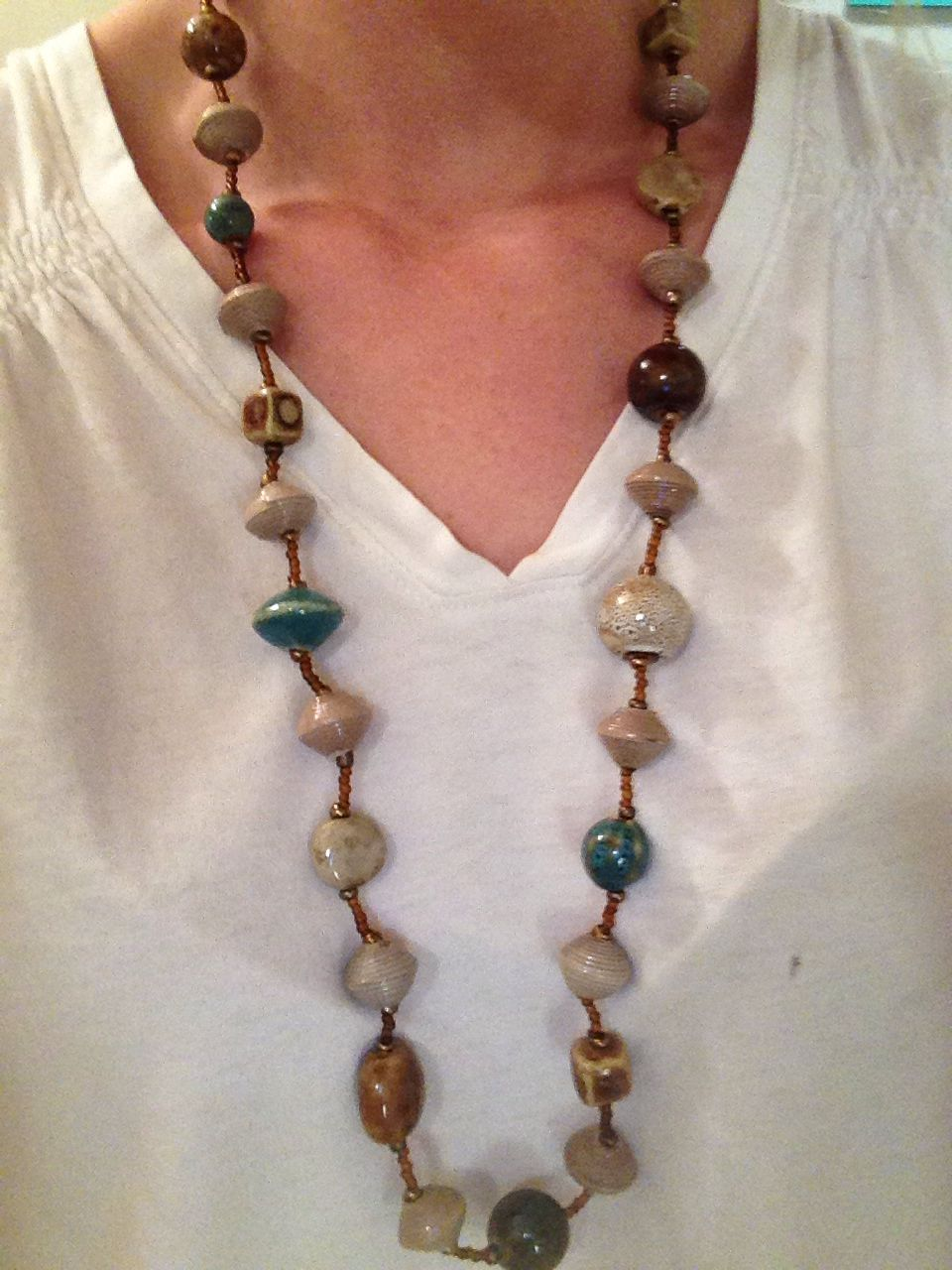 Beautiful clay beads and cereal box beads from Haiti make this awesome Oceans Necklace one of the prettiest fall trends. The soft neutrals w a punch of blue compliment any outfit. #tradesofhope #leslietradesofhope mytradesofhope.com/lesliehouck