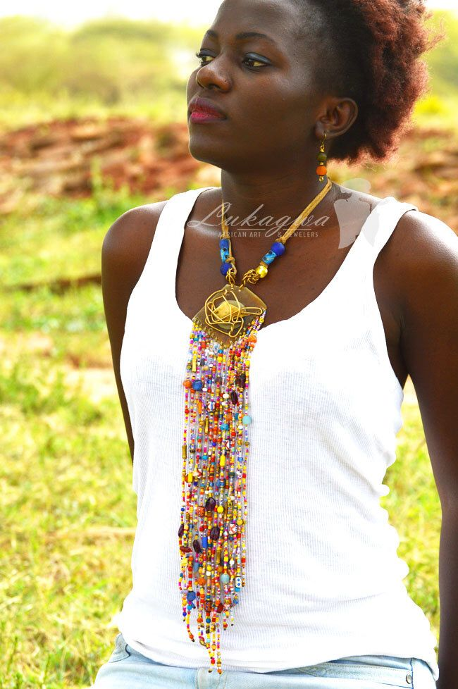 Reserved-Masai Beaded Multistranded Leather necklace,Chunky Masai Beaded Necklace,Multicolored African Jewelry by Lukagwa on Etsy https://www.etsy.com/listing/255491190/reserved-masai-beaded-multistranded