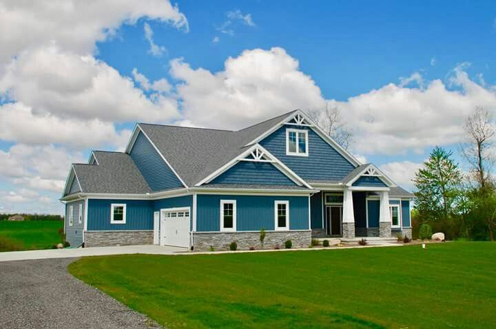 Brand New Rancher With A Roof Over The Front Porch And Gray Vinyl Siding We Love The Black Shutte Ranch House Exterior White Siding House White Vinyl Siding