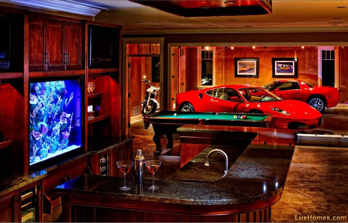 Awesome glass wall between the man cave and garage. Maybe change the garage  to a