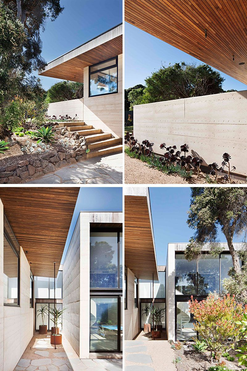The two main building materials of this modern house are rammed earth for the walls and timber used for the overhanging roof