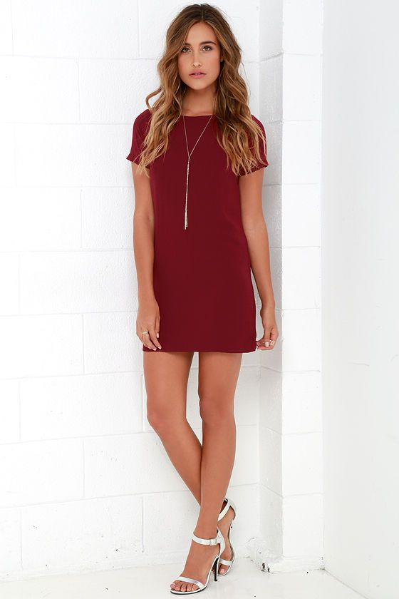 Shimmy, shuffle, and shake in the Shift and Shout Wine Red Shift Dress, because you know you look so good! Woven poly fabric shapes a rounded neckline atop a darted bodice with short sleeves. The shift silhouette falls into a flirty, leg-baring length. Exposed gold zipper at back.
