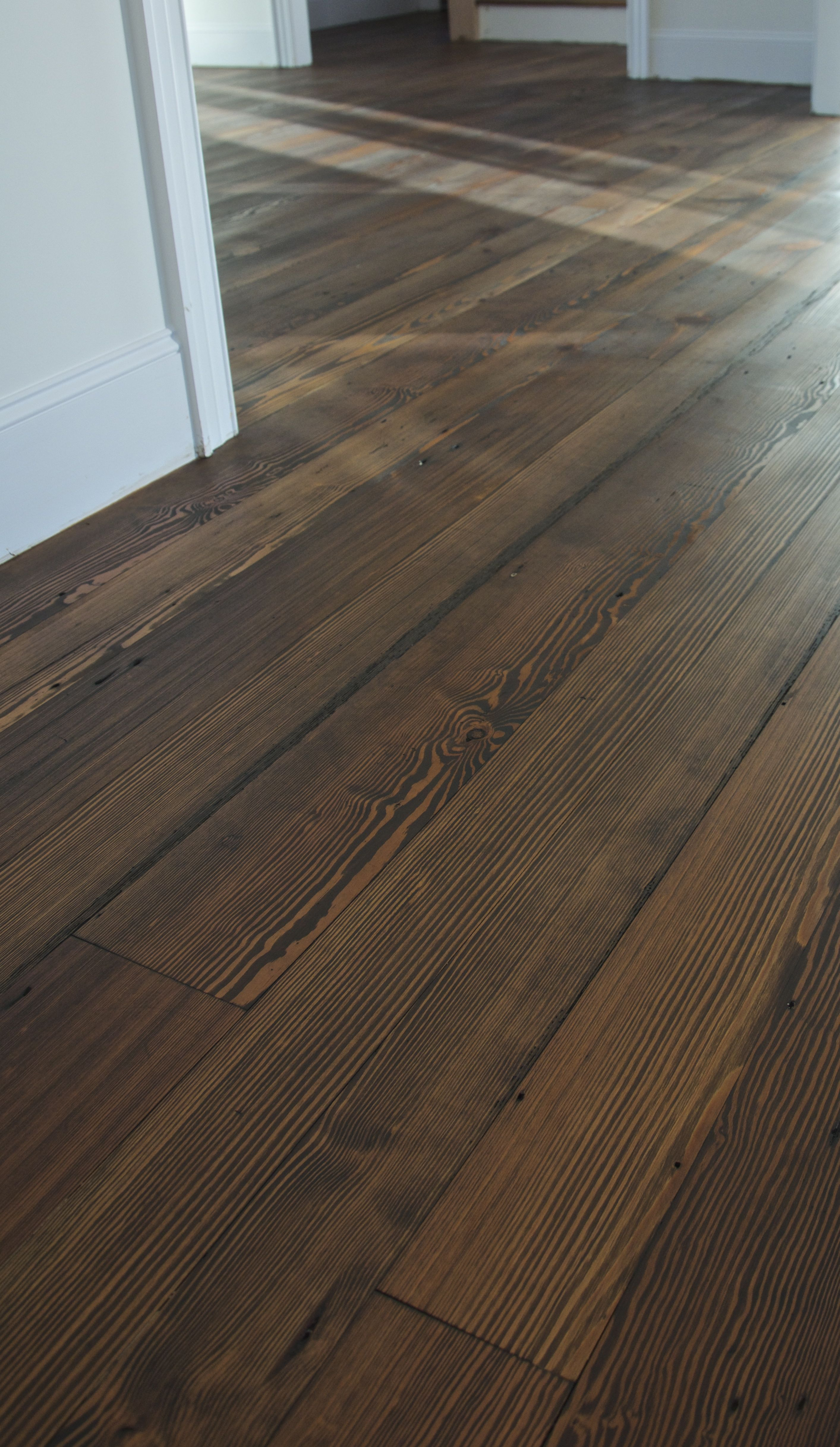 Antique heart pine flooring shown with a dark stain for Pine floors stained dark