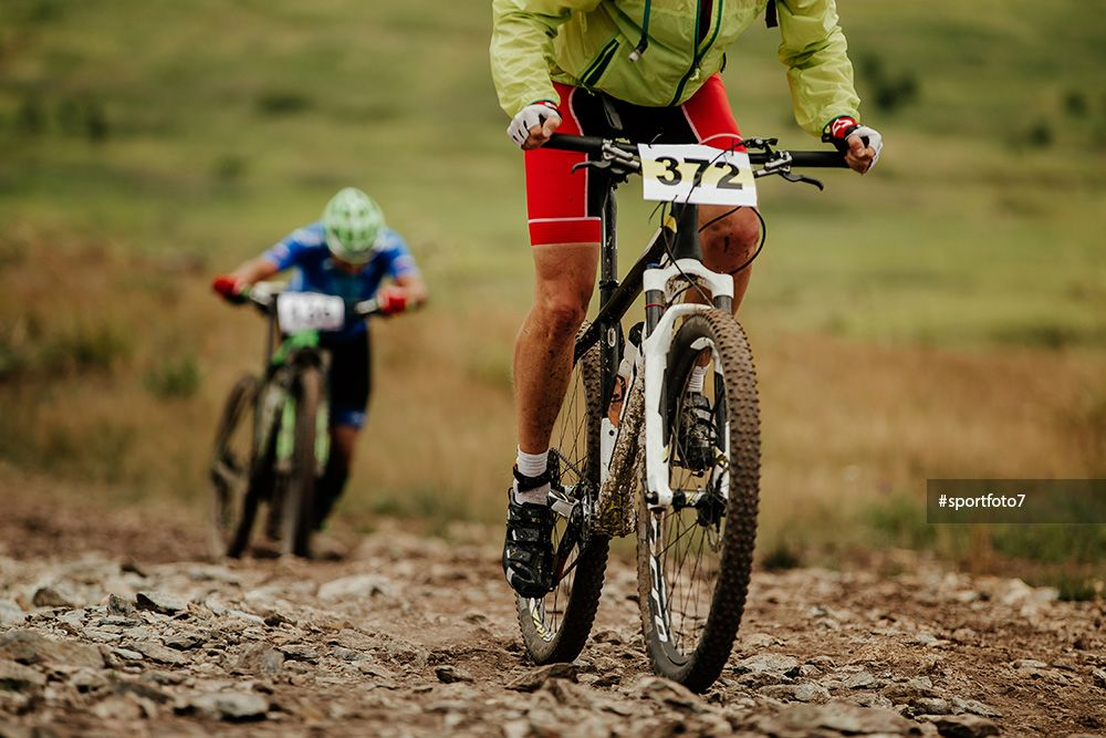 Two Athletes Cyclist Mountain Biking Uphill In Competition Xcm Mountain Biking Cyclist Athlete