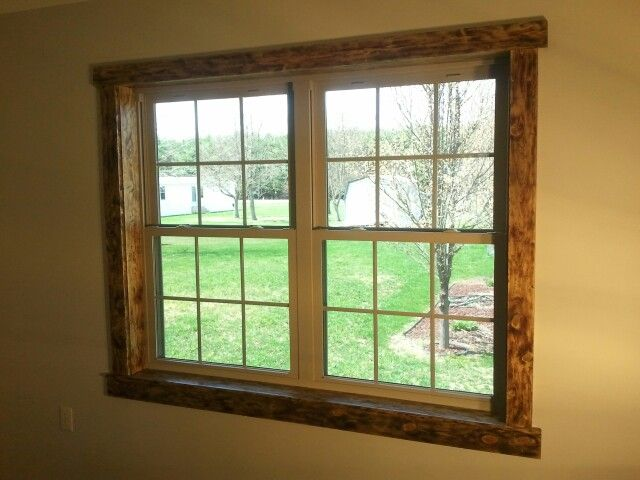 Rustic pine window casing and trim. Distressed wood