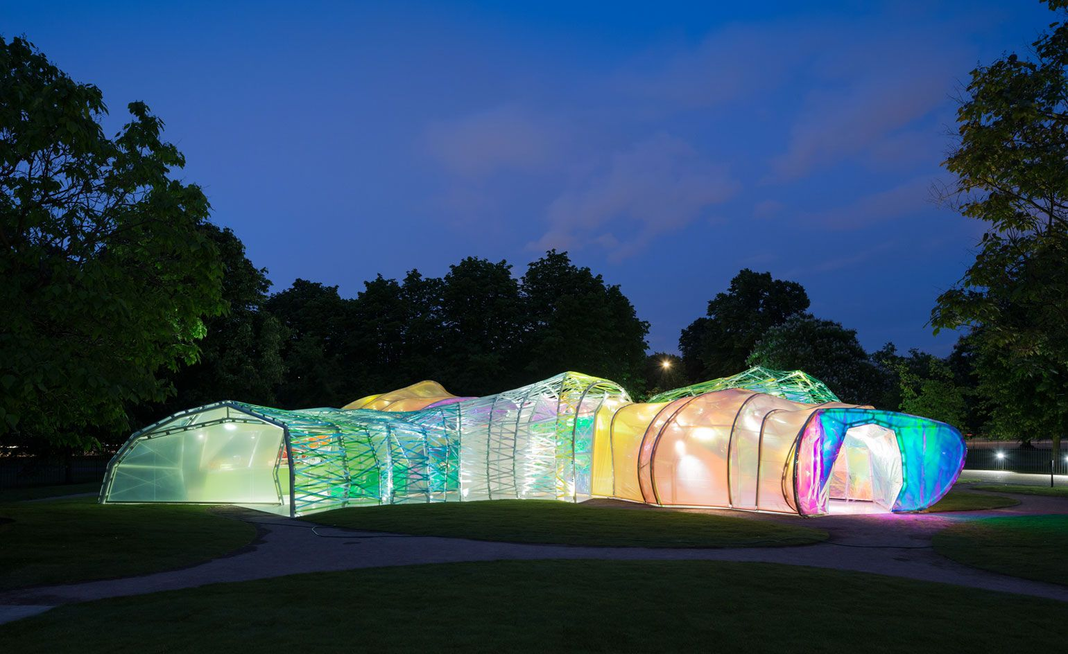 The structure's bright colours come alive at night, when lit from within