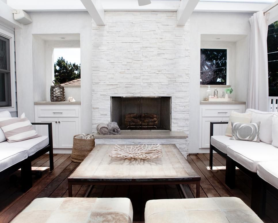 A White Painted Stone Fireplace Serves As The Focal Point