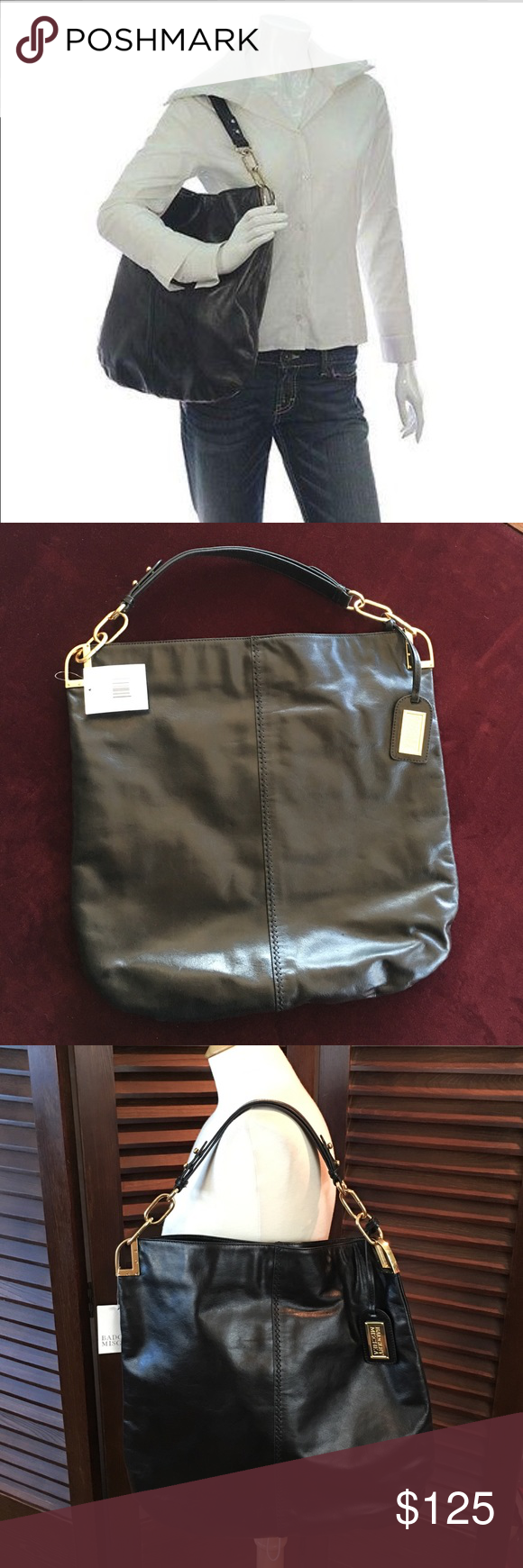 """Badgley Mischka Gaia Black Leather Tote Handbag Brand new with tags.  Dimensions are:  16 3/4"""" long, 16 1/2"""" high, and depth is approx. 1/2"""".  This tote has a single magnetic snap closure with one main large compartment.  The interior lining is solid black with one small zip pocket and two small open pockets (the layout you find in most handbags).  Comes with dust bag. Badgley Mischka Bags Totes"""