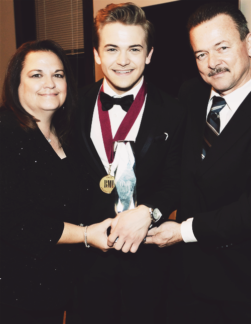 Hunter and his parents!!! This picture makes my heart swell with love and pride<3 They look so happy and sweet!