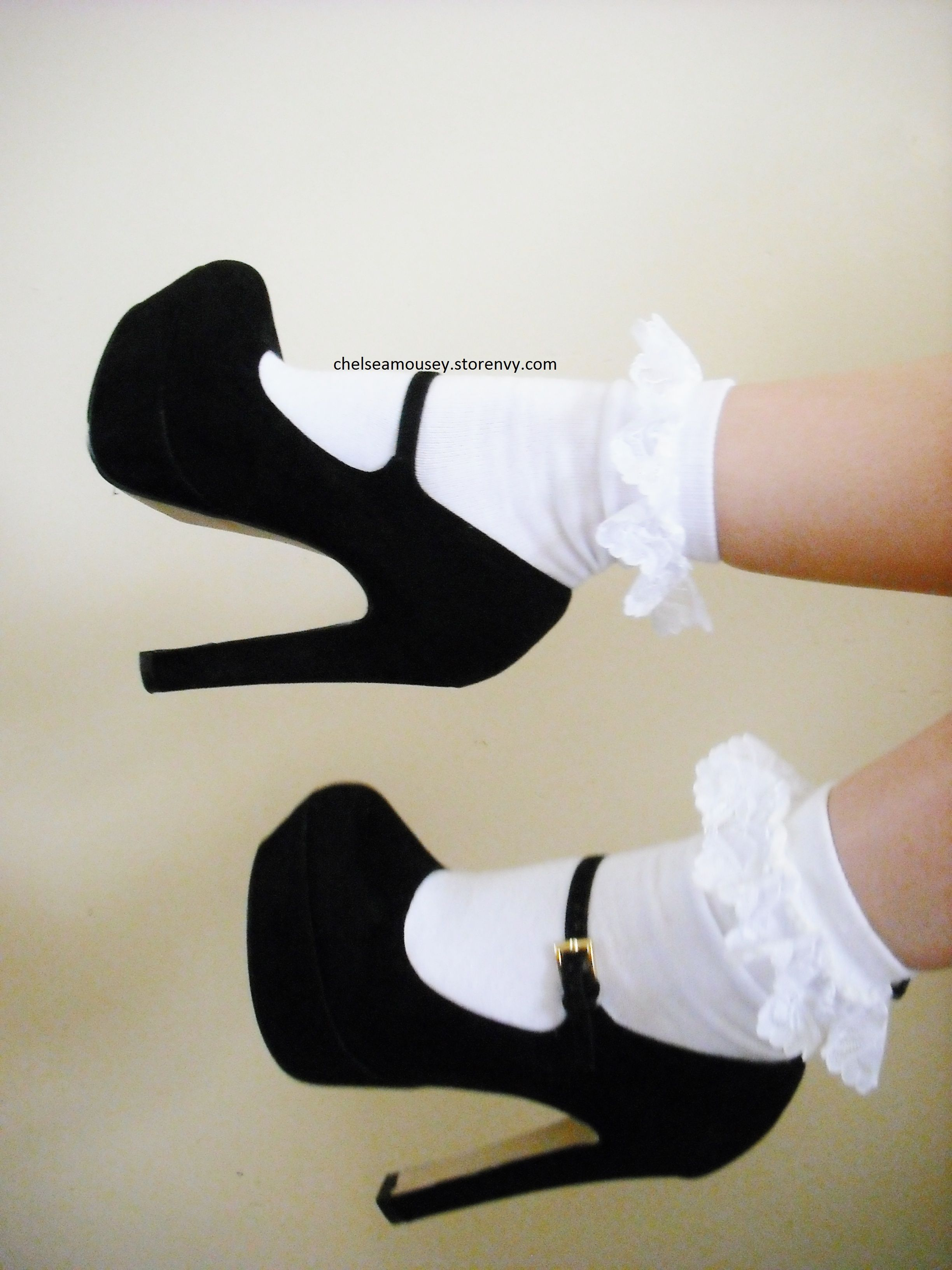 Black high heel shoes with white lace ruffle socks