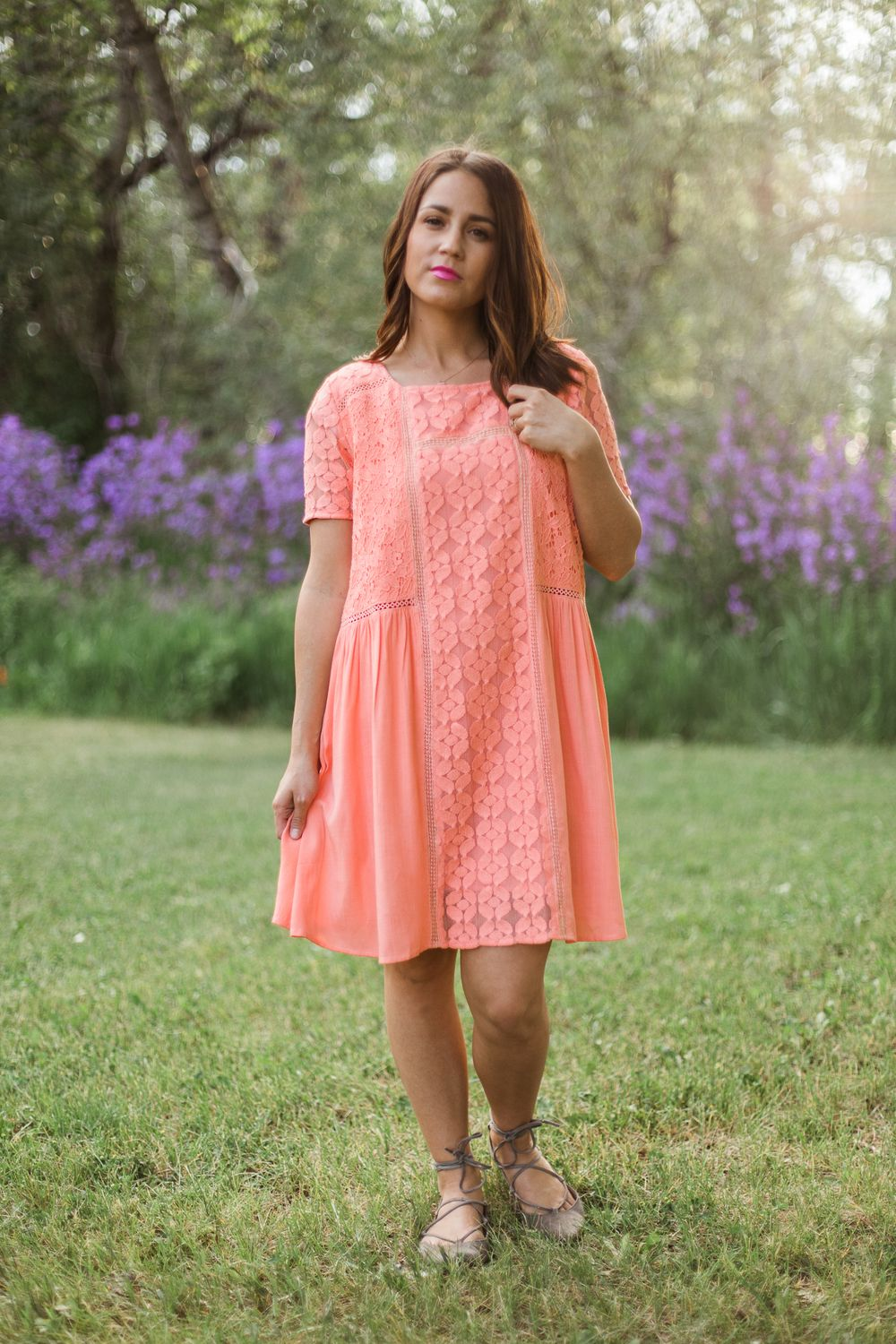 Peach colored dress with lace and crocheted details.  Fully lined  Model is…