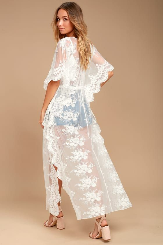 17850bb0006 Gorgeous white lace forms this open front kimono with kaftan sleeves