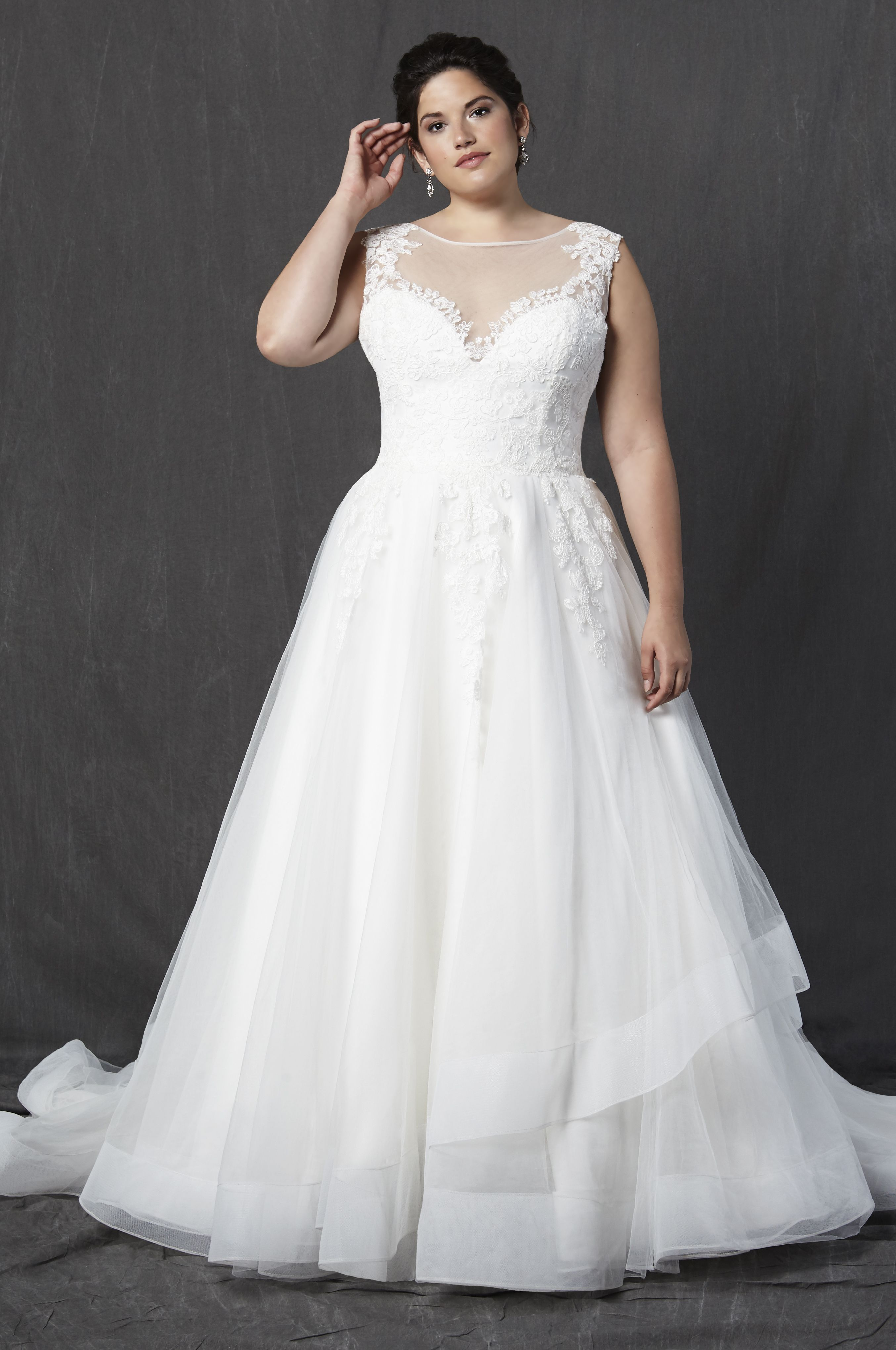 Ivory tulle and lace bridal gownbateau illusion neckline