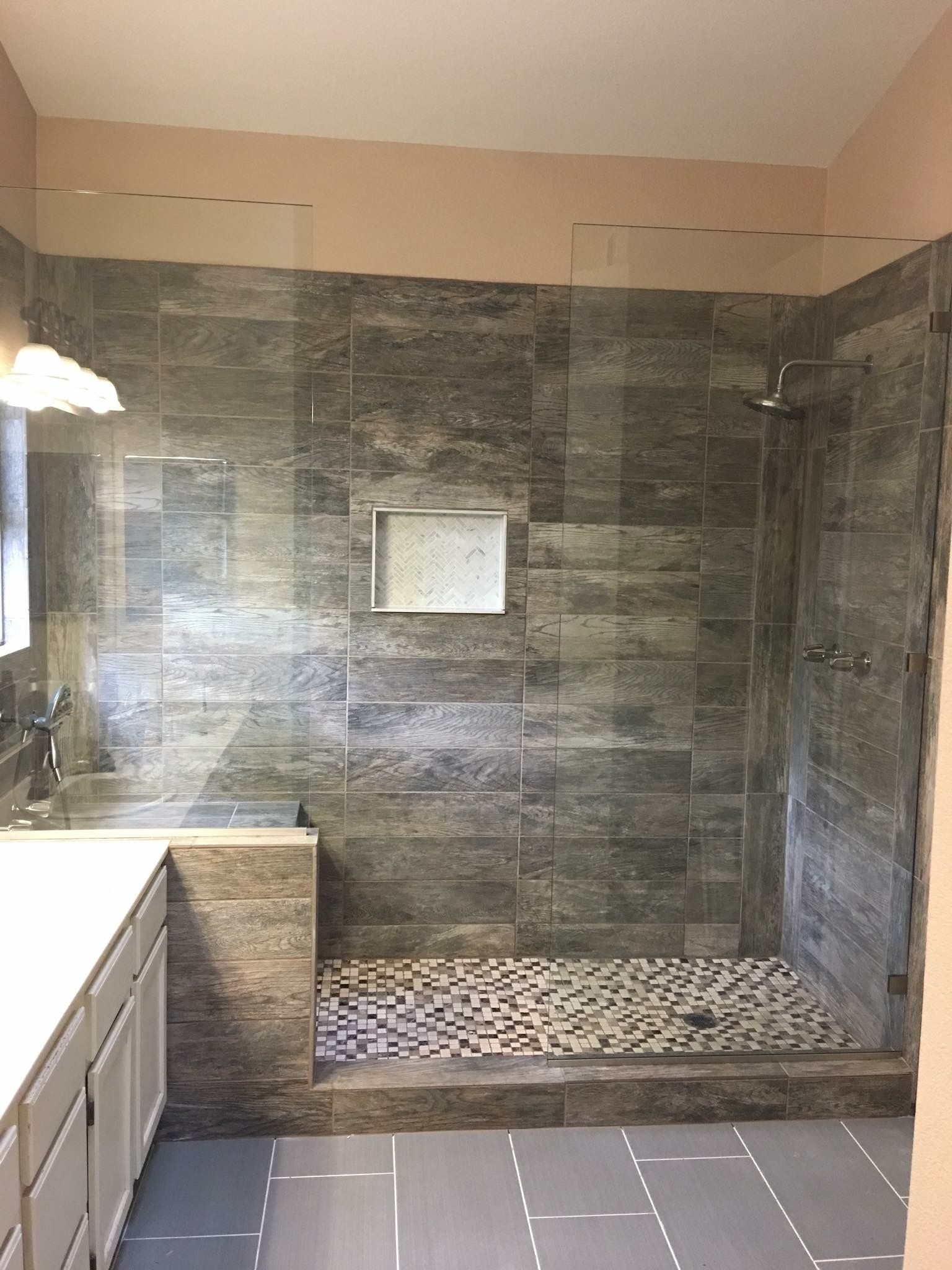 Large Tile Shower With Double Shower Heads And Bench Seat