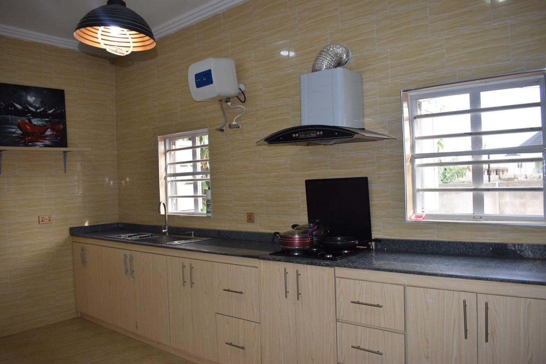 Kitchen. Yellow tiles. Bare windows. Nigerian kitchen. Nigerian ...