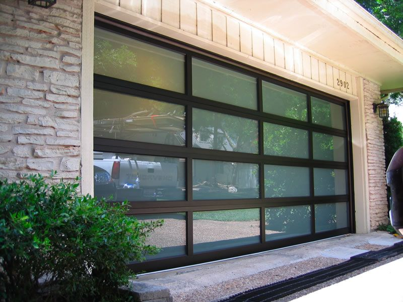 Black Anodized Garage Door With Frosted Glass Installed In Westlake