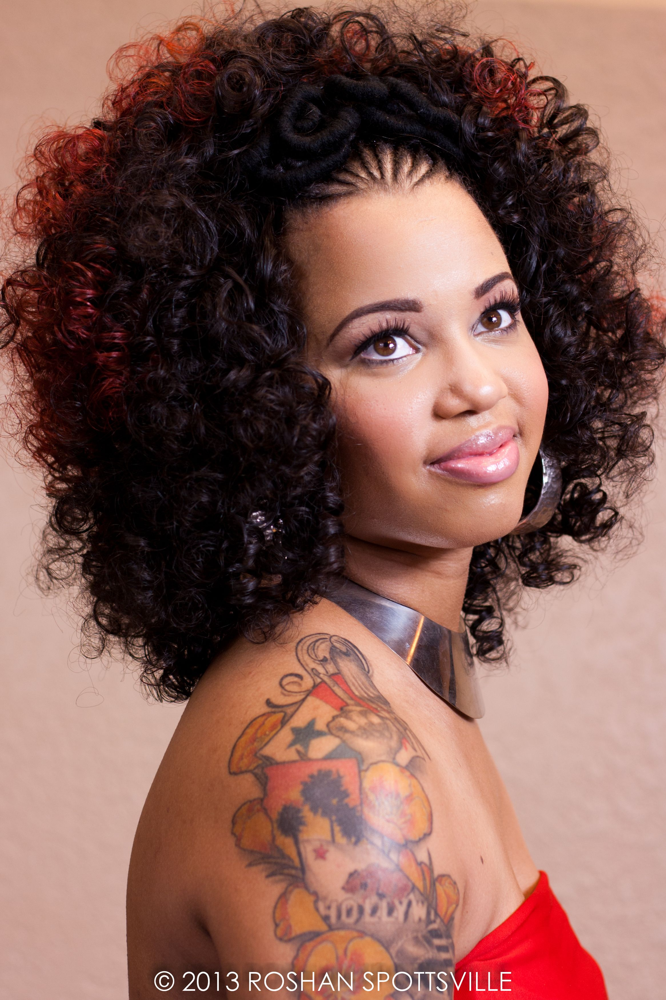 curls w/red ombre weave... cornrows with yarn tread wraps