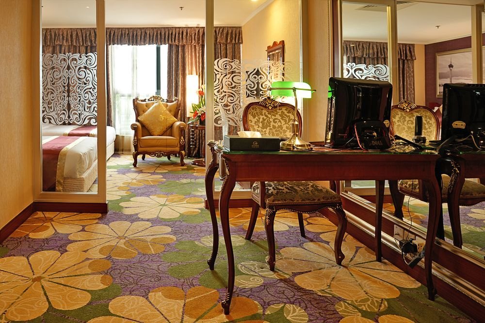 Guestroom carpet with floral design in yellow, violet