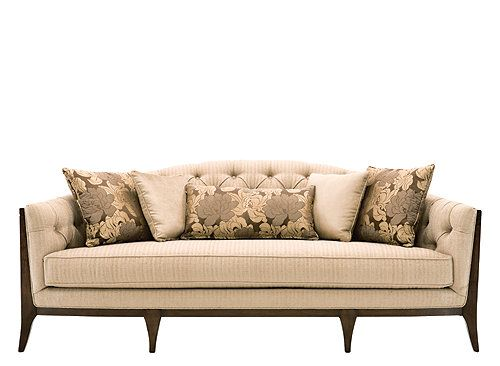 This Maxine chenille sofa s softly curved design exposed wood