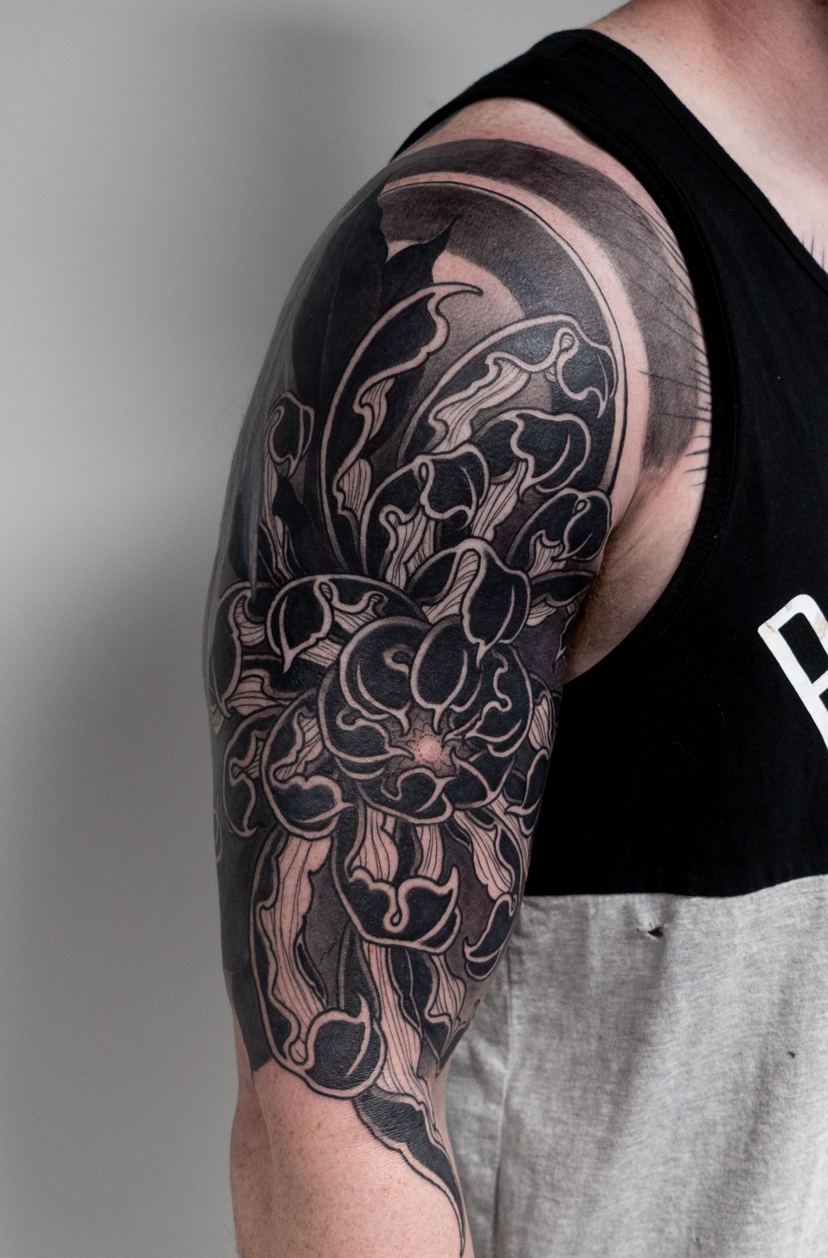 A Chrysanthemum Displayed In Black Grey Tattoo Work Tattoos Tattooart Tattooer Tattoo Tattooartist Tat Tattoos Black And Grey Tattoos Tattoo Magazines