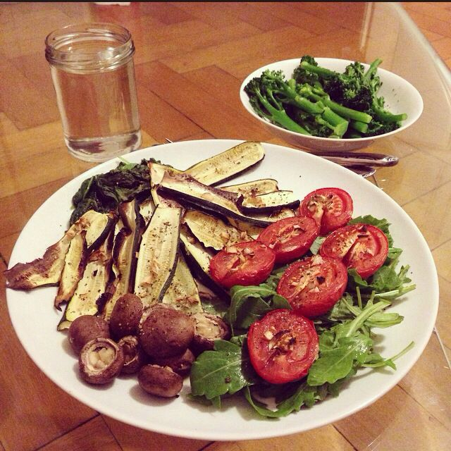dinner from last night: oven-baked mushrooms, tomatoes and zucchini with garlic and italian herbs and cilantro. arugula, spinach and baby broccoli aside!'. Very very tasty!