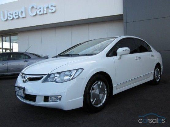 2006 Hybrid, $13,990, climate control and cruise, cream interior, dealer, 119km.