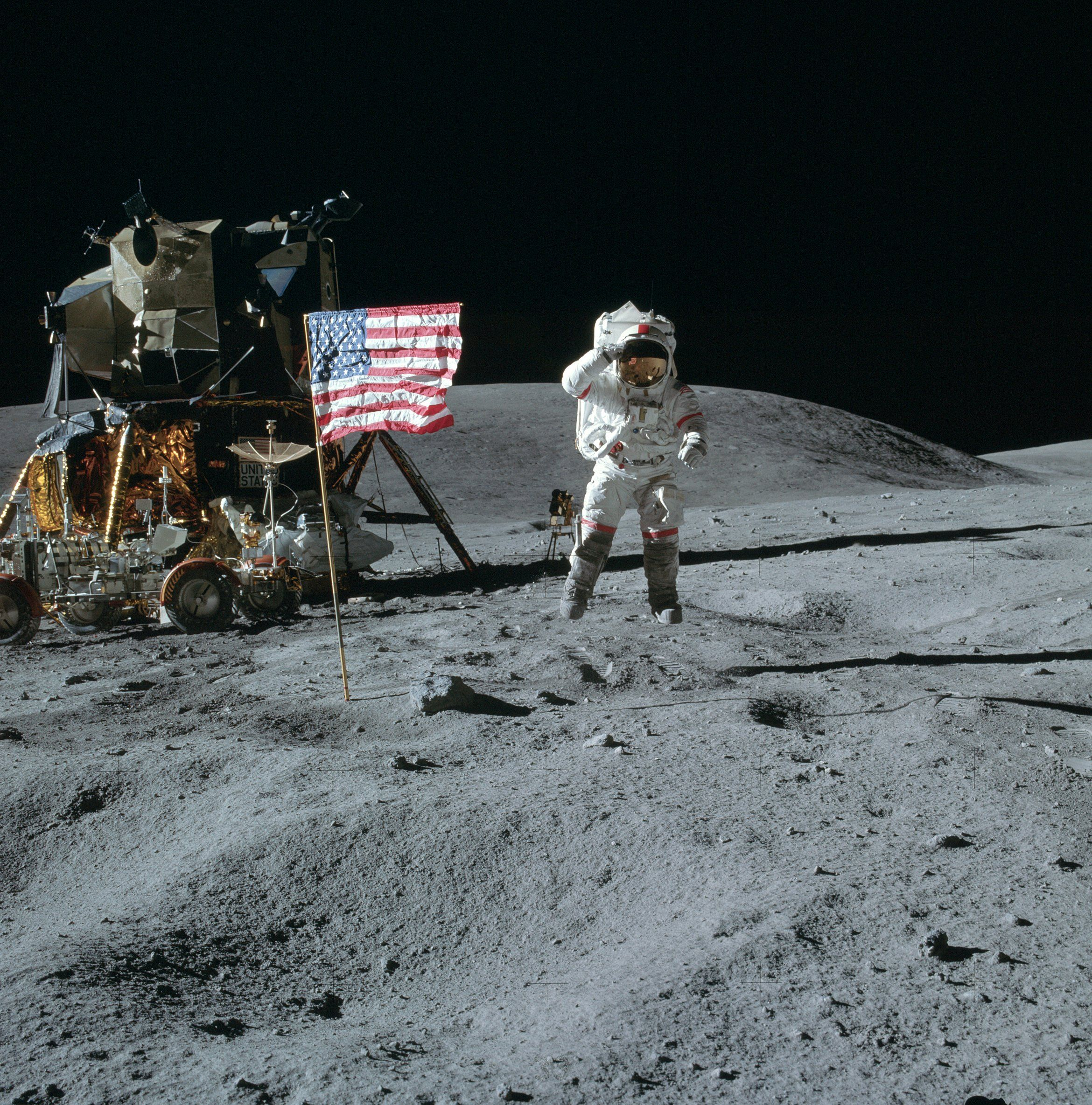 Apollo 16  John Young jumps off the ground and salutes for this superb tourist picture.