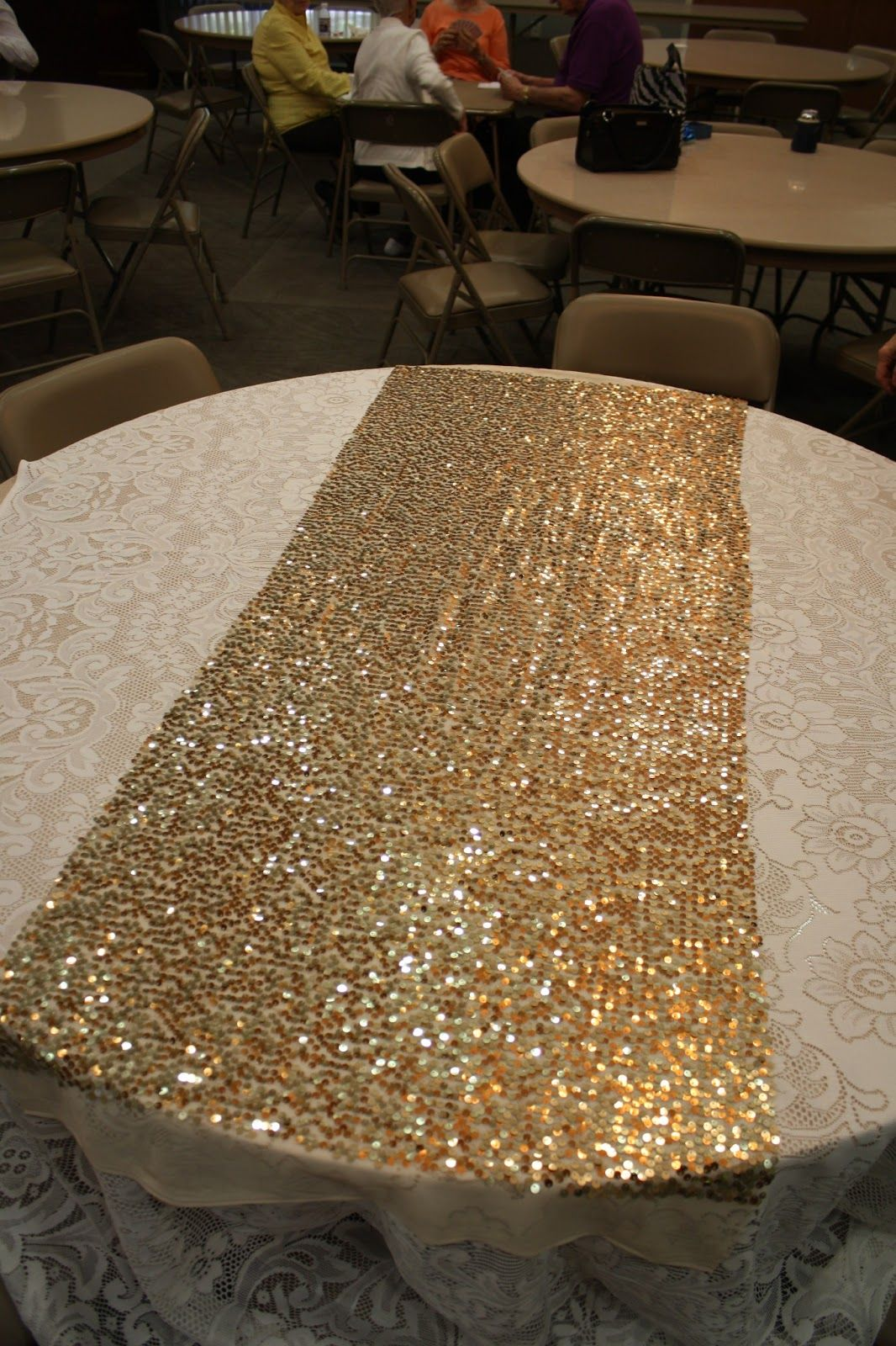 sparkly gold sequin table runner - hire