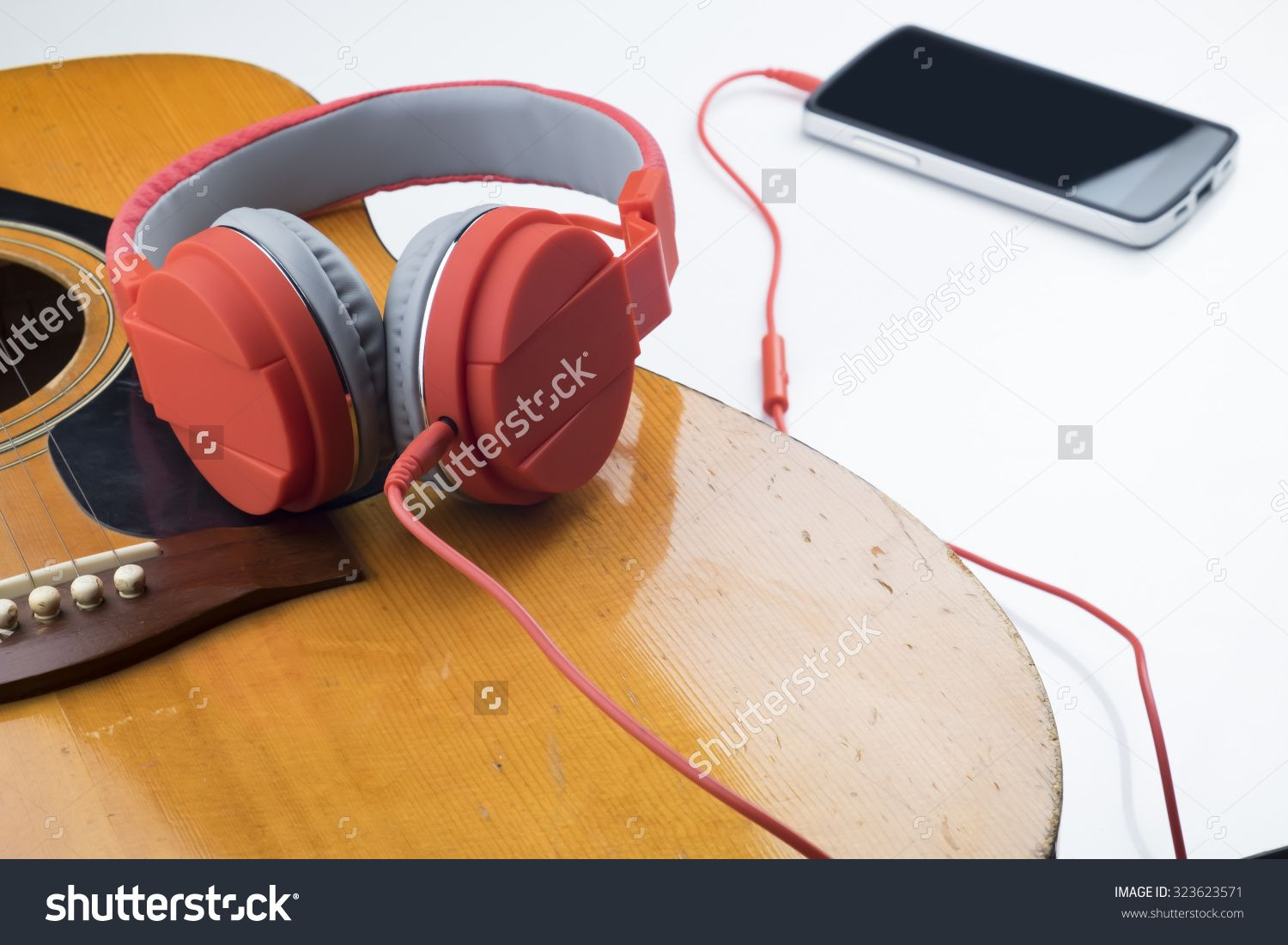 Relaxing Time Red Earphone On Guitar Connect With Smart Phone Over White Background Stock Photo 323623571 Shutterstock