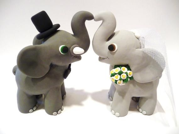 This couple is handmade from clay without the use of molds. Both measure approx. 3 1/4 inches from their feet to the top of their trunk and measure approx. 5 inches in length from the hind legs of the groom to the hind legs of the bride (when facing each other). These two are custom made to fit your