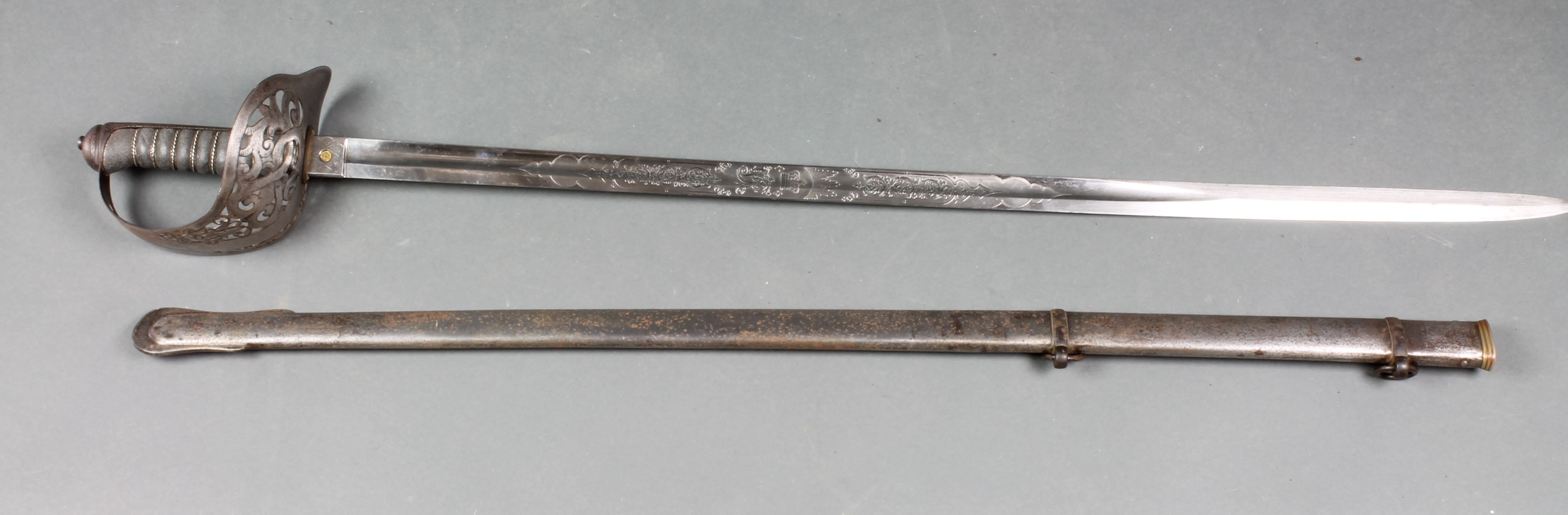 Lot 192, An 1897 pattern Henry Wilkinson Victorian Infantry Officer's sword with etched blade marked 16058 complete with scabbard, est £100 - 150