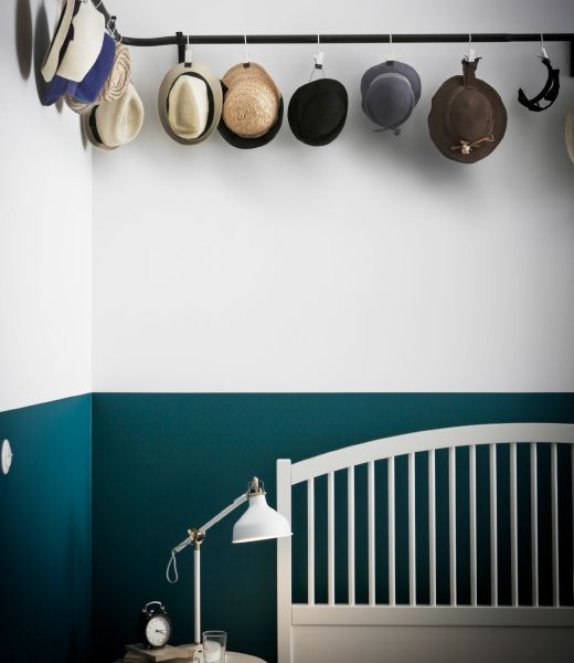 Different Hats Are Hung From An Ikea Hugad Curtain Rod With Ikea