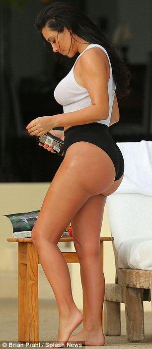 d7b682246a4c2 Kim Kardashian cools off in daring see-through bathing suit   kim kardashian    Think, Promis, Hot