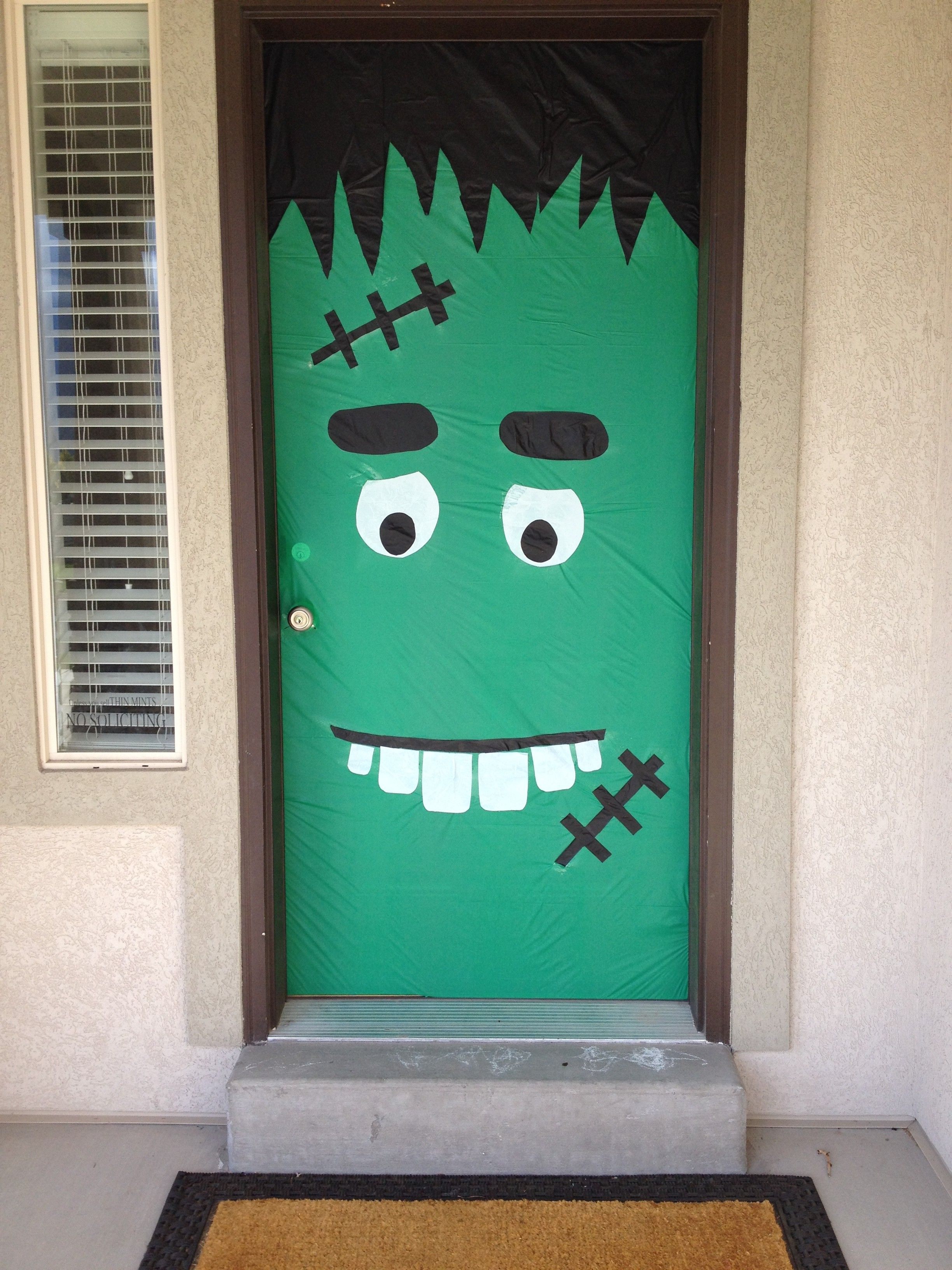 Halloween Door Decoration - $3 in Dollar Store plastic table covers and  spray adhesive! Events