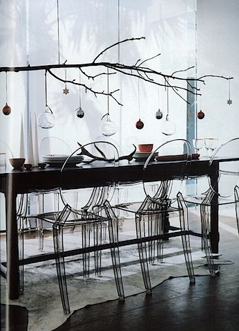 Christmas table setting. Baubles, ghost chairs, decorations.