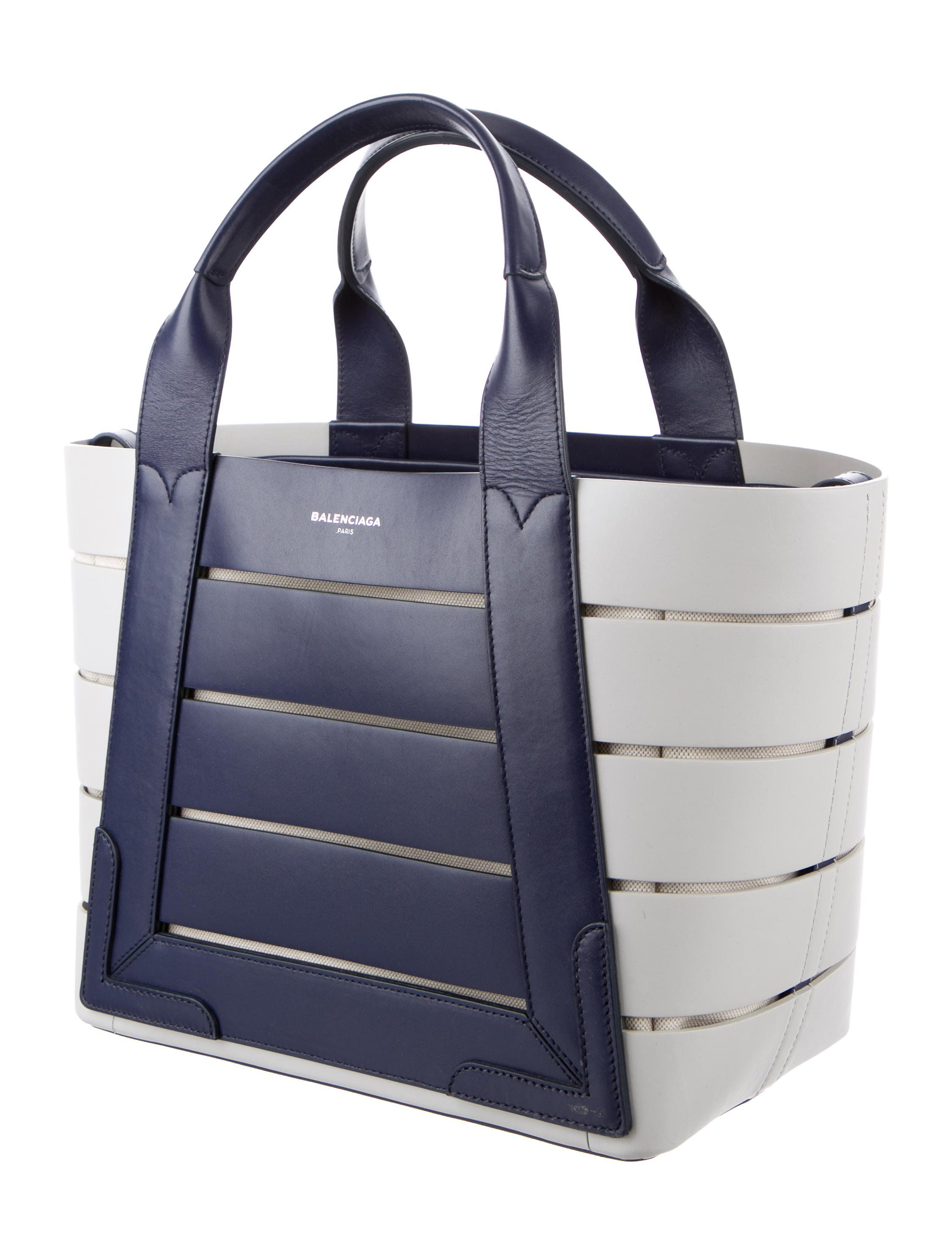 00471930d1 Navy and creme leather Balenciaga Small Cabas tote with silver-tone  hardware, dual flat top handles, natural canvas lining, single zip pocket  at interior
