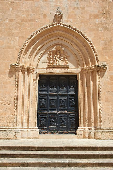 The Italian Gothic ogival main door of the medieval Cathedral of Ostuni built between 1569-1495. Ostuni, The White Town, Puglia, Italy.