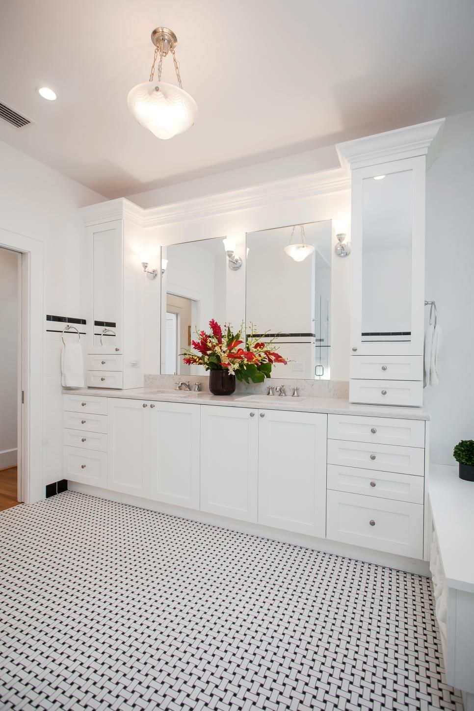 This Bathroom Remodel Features A Long White Vanity With Double Sinks Extra Cabinets And