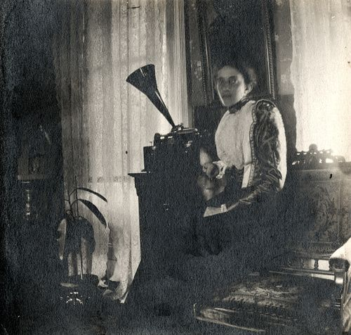 Woman with Edison's Home Model A wax cylinder phonograph, ca. 1900.